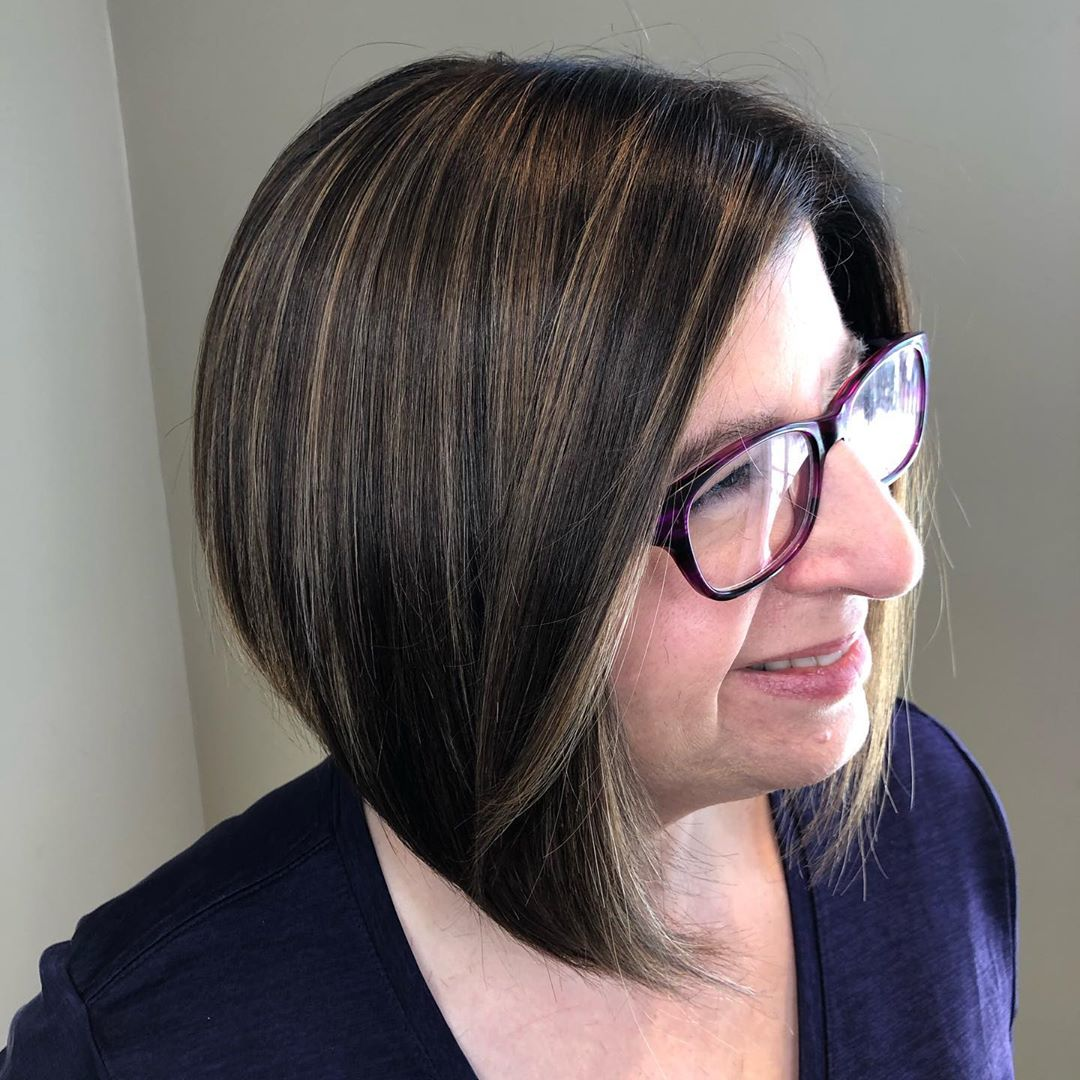 face framing inverted bob for women over 50 with round face