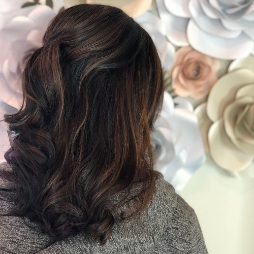 Picture of a fantastic dark hair half updo