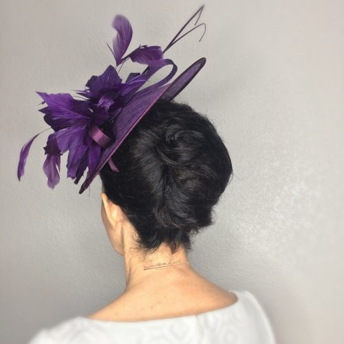 Twisted updo with a hat