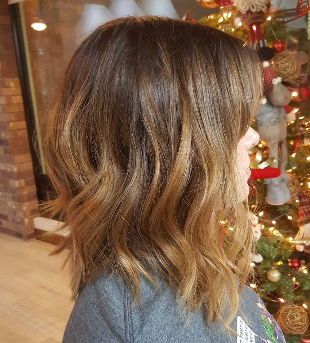An amazing chocolate brown and caramel lob hair color and cut