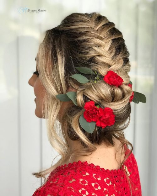 Picture of a flower adorned braid wedding updo