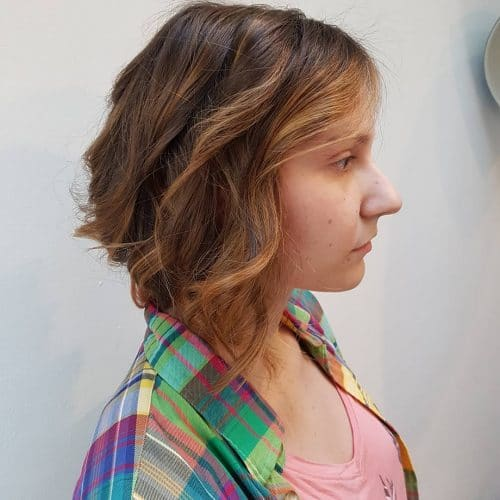 A short collarbone layered bob with highlights