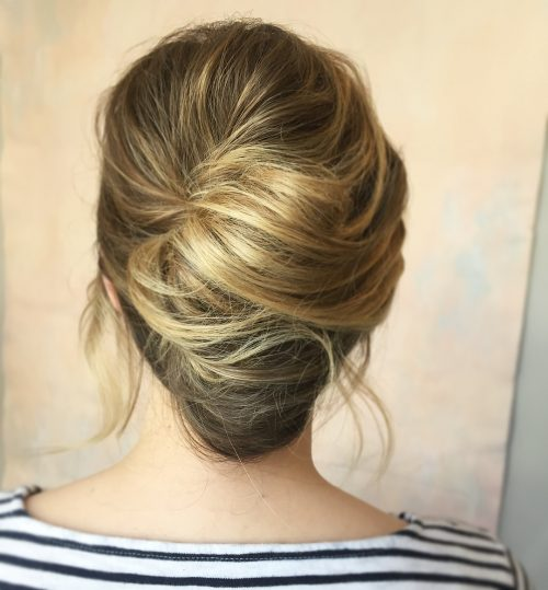 A medium layered french twist hairstyle