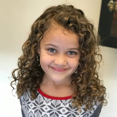 Picture of fresh and bouncy deva cut for girls with curly hair
