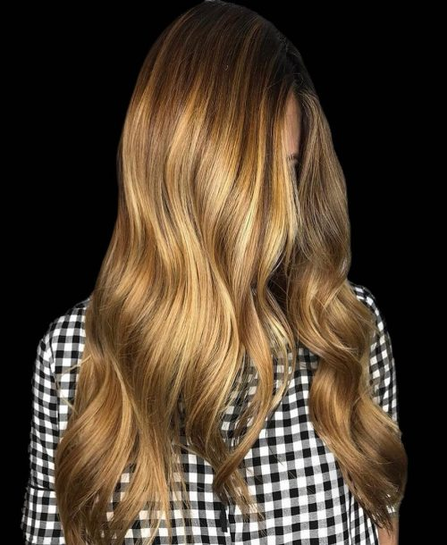 A glossy gold light brown hair color