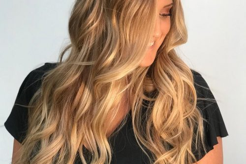 Golden blonde highlights on long hair and tan skin