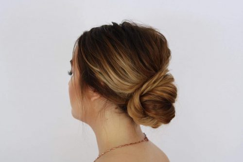 Picture of a golden brown low updo for prom