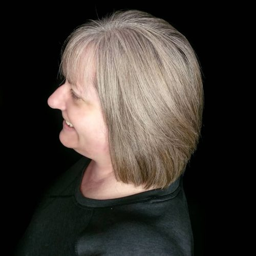 A medium layered hairstyle for women over 50
