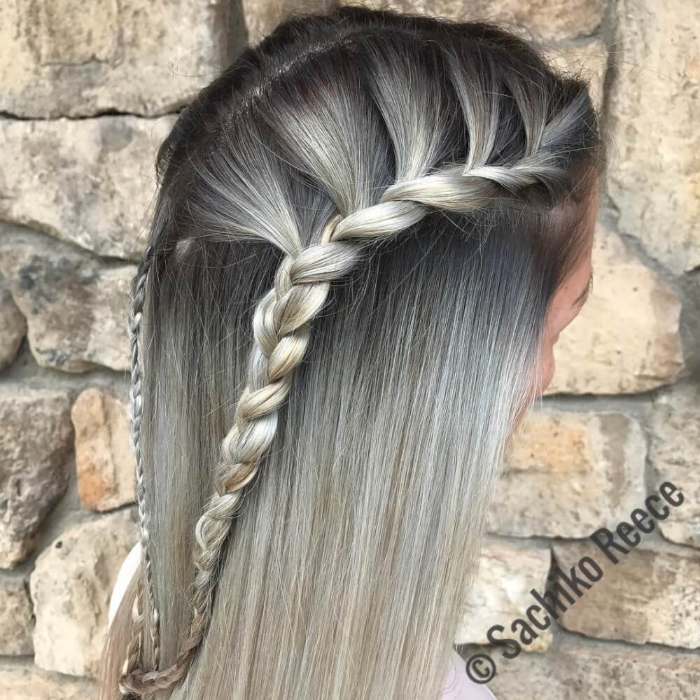 A black silver hair color with braids