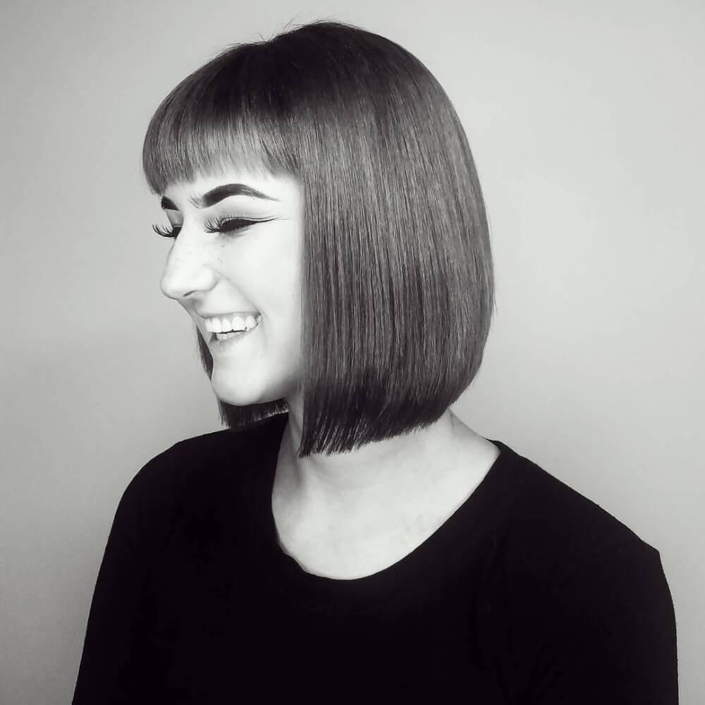 A clean symmetrical Bob haircut with bangs