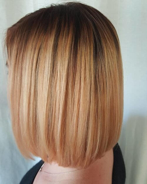 hints of strawberry blonde in hair