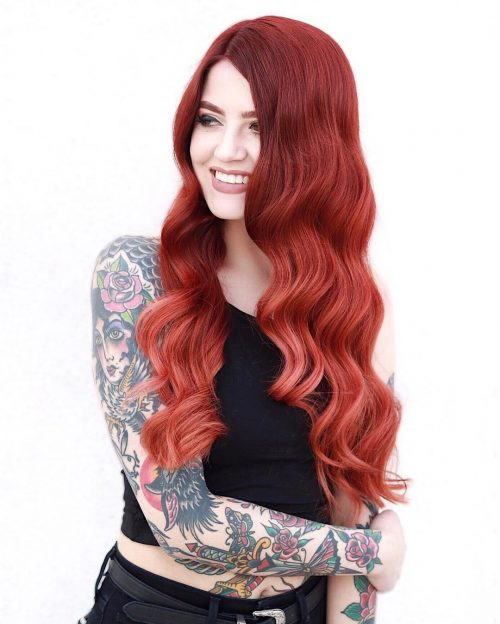 A dark red to strawberry red ombre hair color