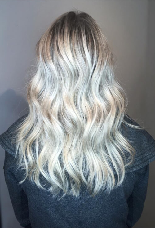 A lived-in platinum blonde hair dye job
