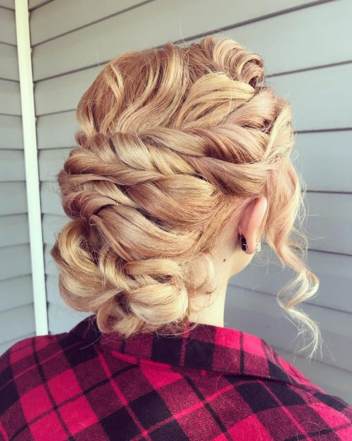 Picture of an impressive honey blonde textured long updo for prom