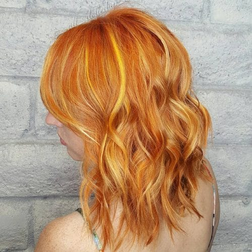 Intense Copper hair color with yellow highlights