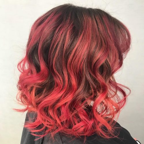 Dark brown hair with strawberry highlights