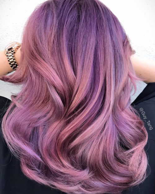 A rose gold ombre hair color