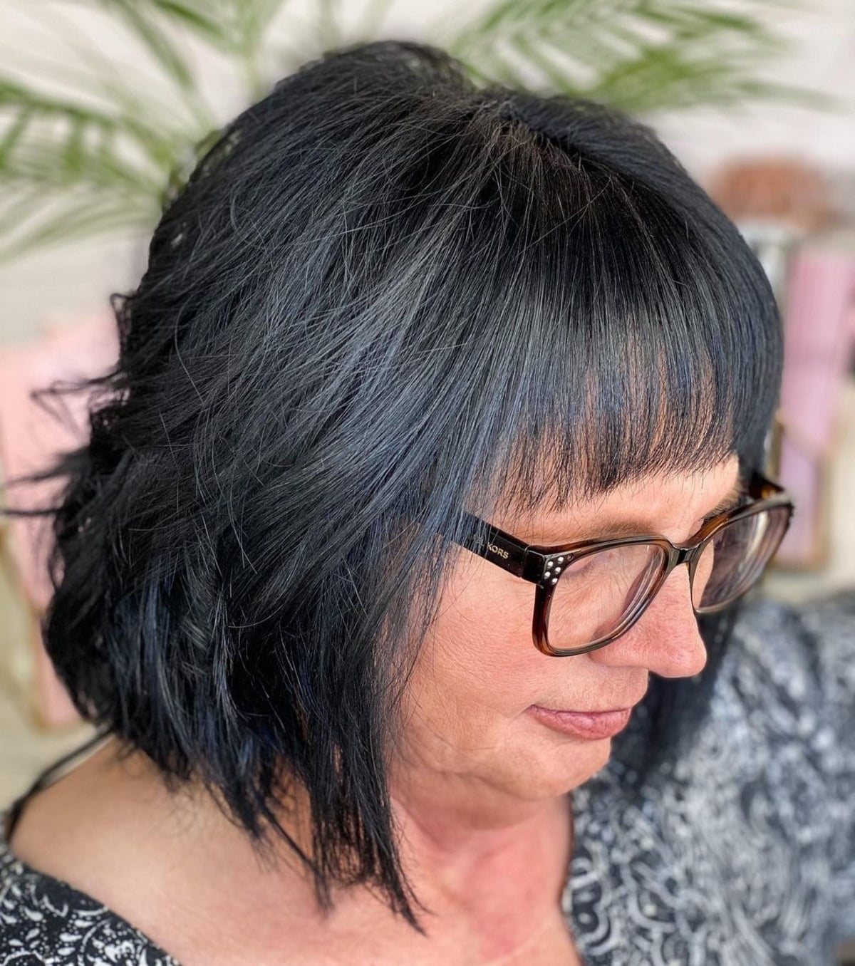 Layered bob for 60-year-old women with glasses