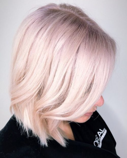 Platinum blonde hair with lilac purple color
