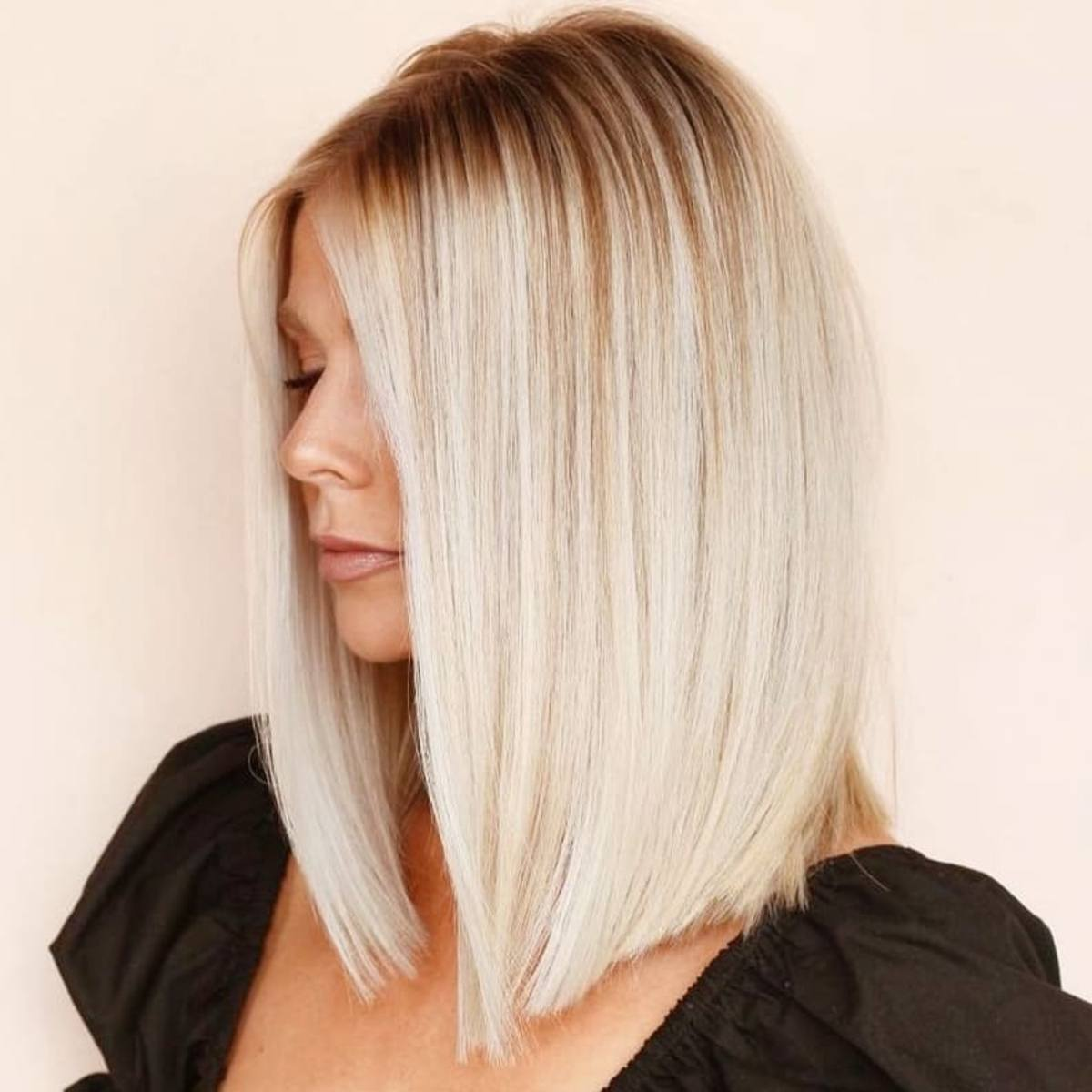 Lob on straight blonde hair with dark roots