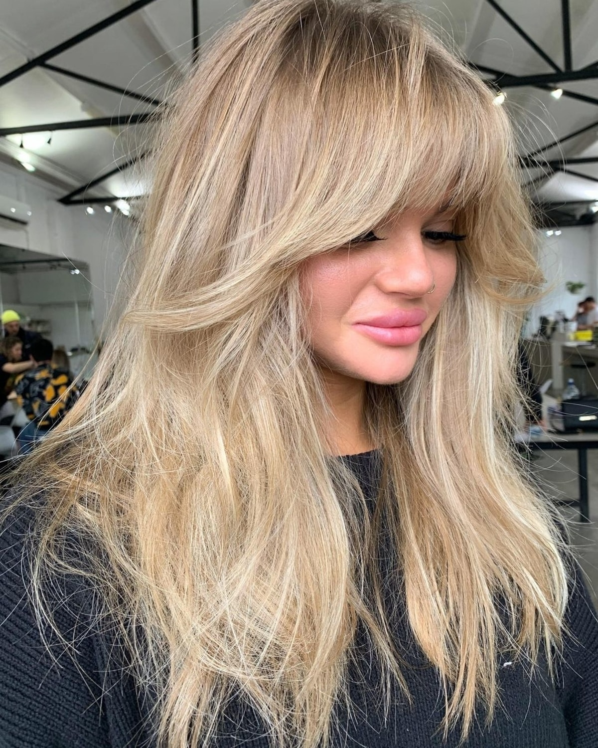Long Blonde Hair with Bangs and Short Layers