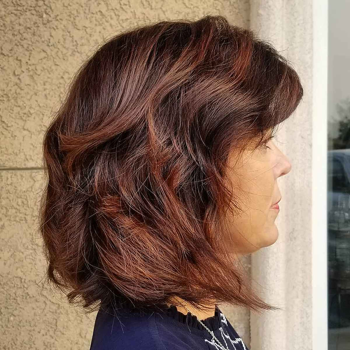 Long Bob Hairstyle with Rich Burgundy Highlights