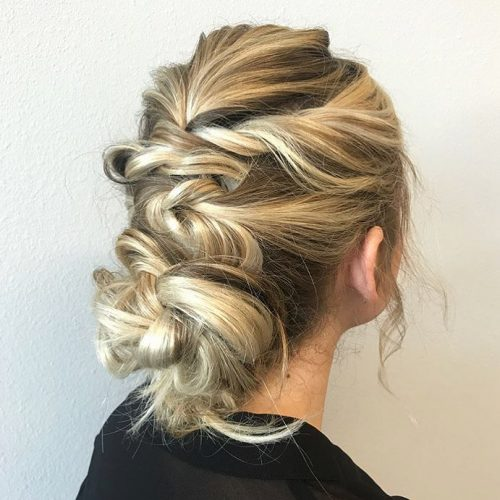 Picture of a long boho updo bun for prom