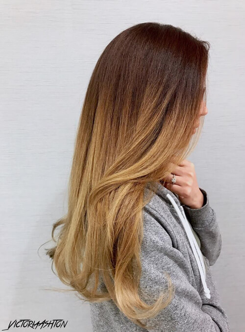 A long ombre from walnut brown to dark blonde hair