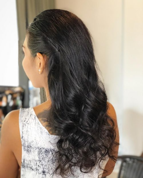 Picture of a long jet black curls for an evening out