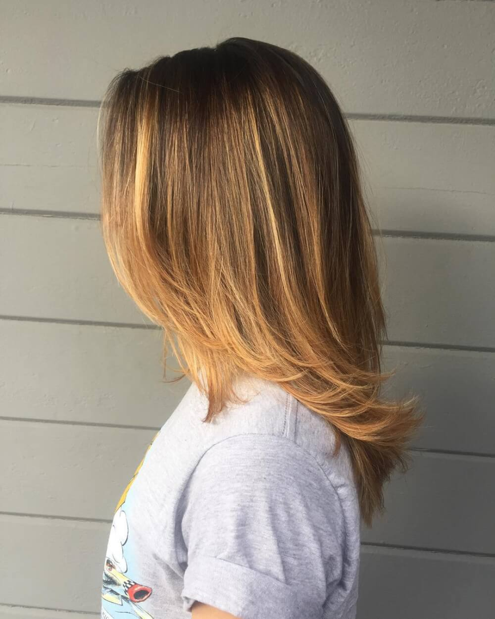 A lovely balayage shoulder length layers