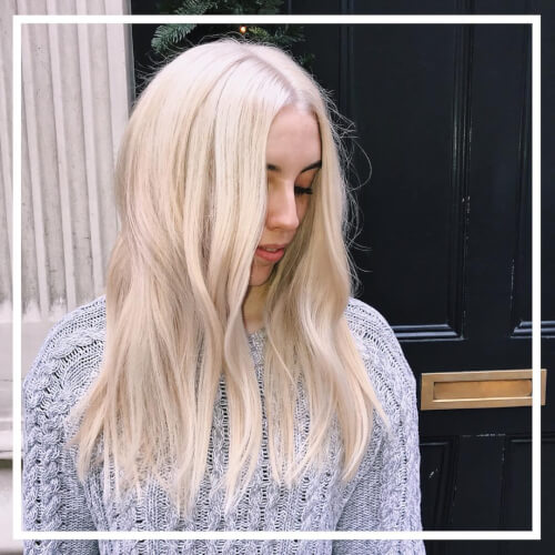 A long relaxed platinum blonde hair color