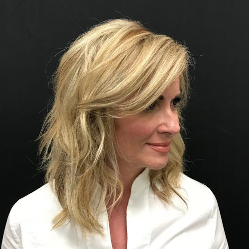 Picture of a long side swept bangs on a shoulder length hair
