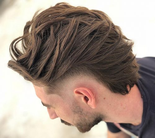 Corte de pelo más largo con alto desvanecimiento.