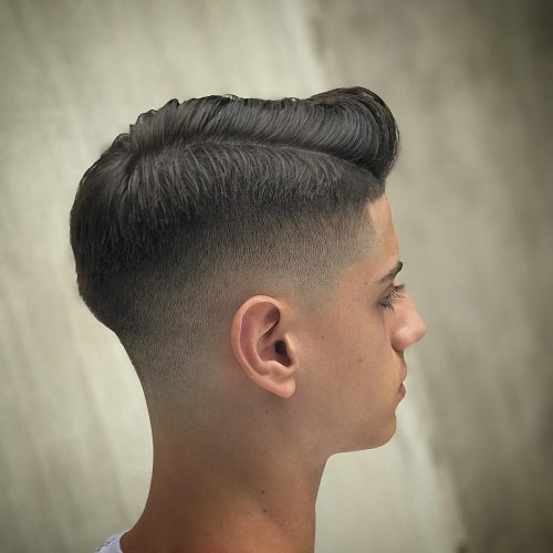 Low fade haircut with a comb over