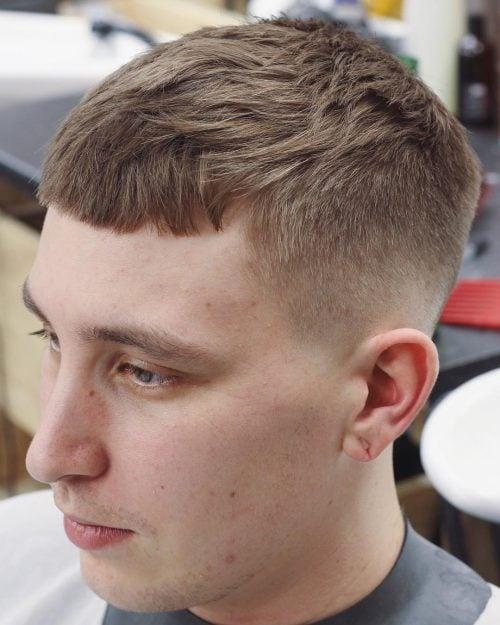 Cultivo texturizado con corte de pelo de bajo desvanecimiento