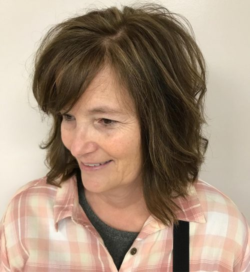 Medium length cut with bangs for women over 50