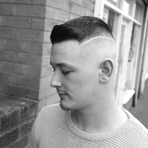 Side part crew cut with a surgical line part
