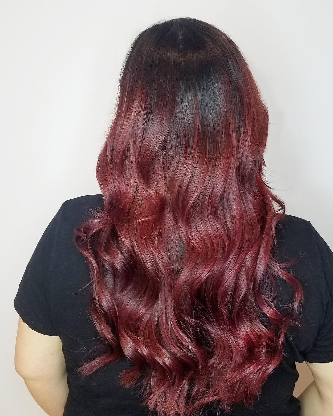 Dark roots with purple merlot wine hair color