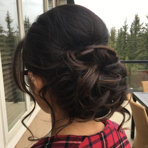 Messy Bun with Loose Curls hairstyle
