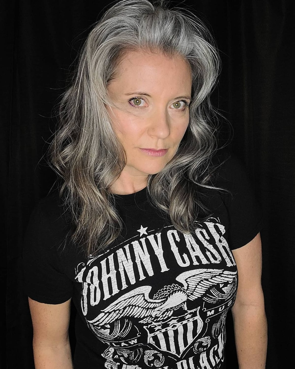 Mid length wavy hair for women over 60 with grey hair