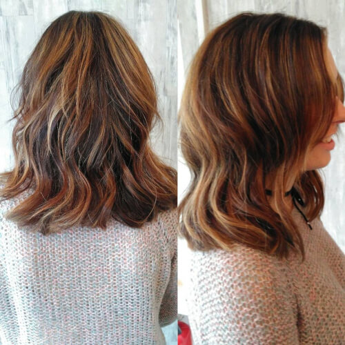A multi tonal dark brown shoulder length hair cut and color