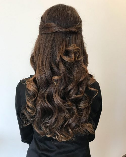 A pulled back half updo for prom