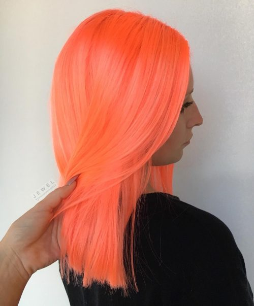 Noticeable Neon Peach Orange Hair Color