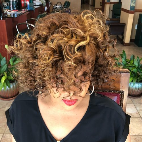 Picture of a noticeable naturally curly brunette honey brown hair