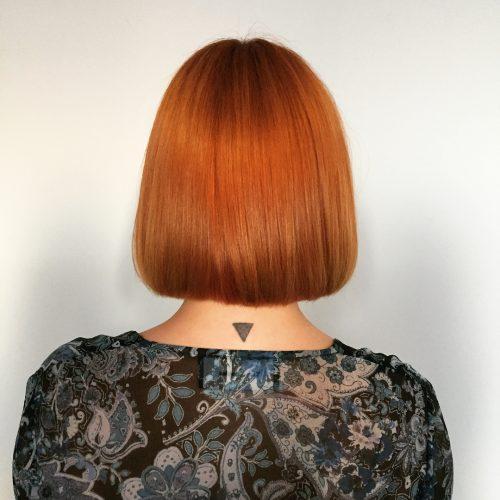 Blunt bob with orange auburn hair