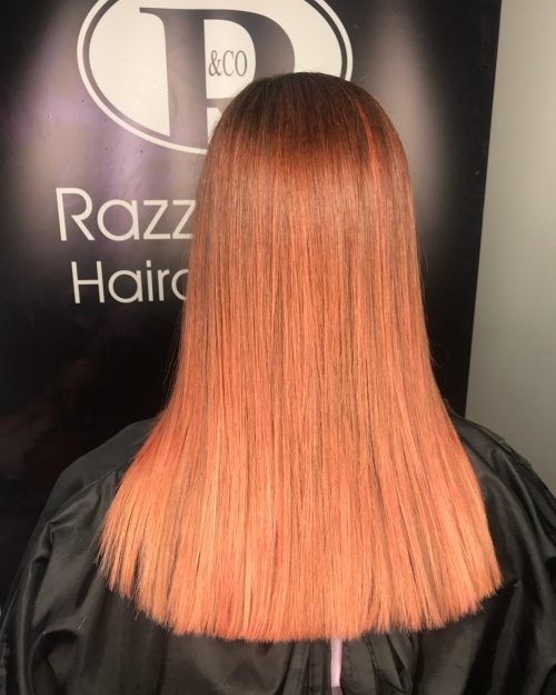 Picture of an outstanding orange to rose gold hair