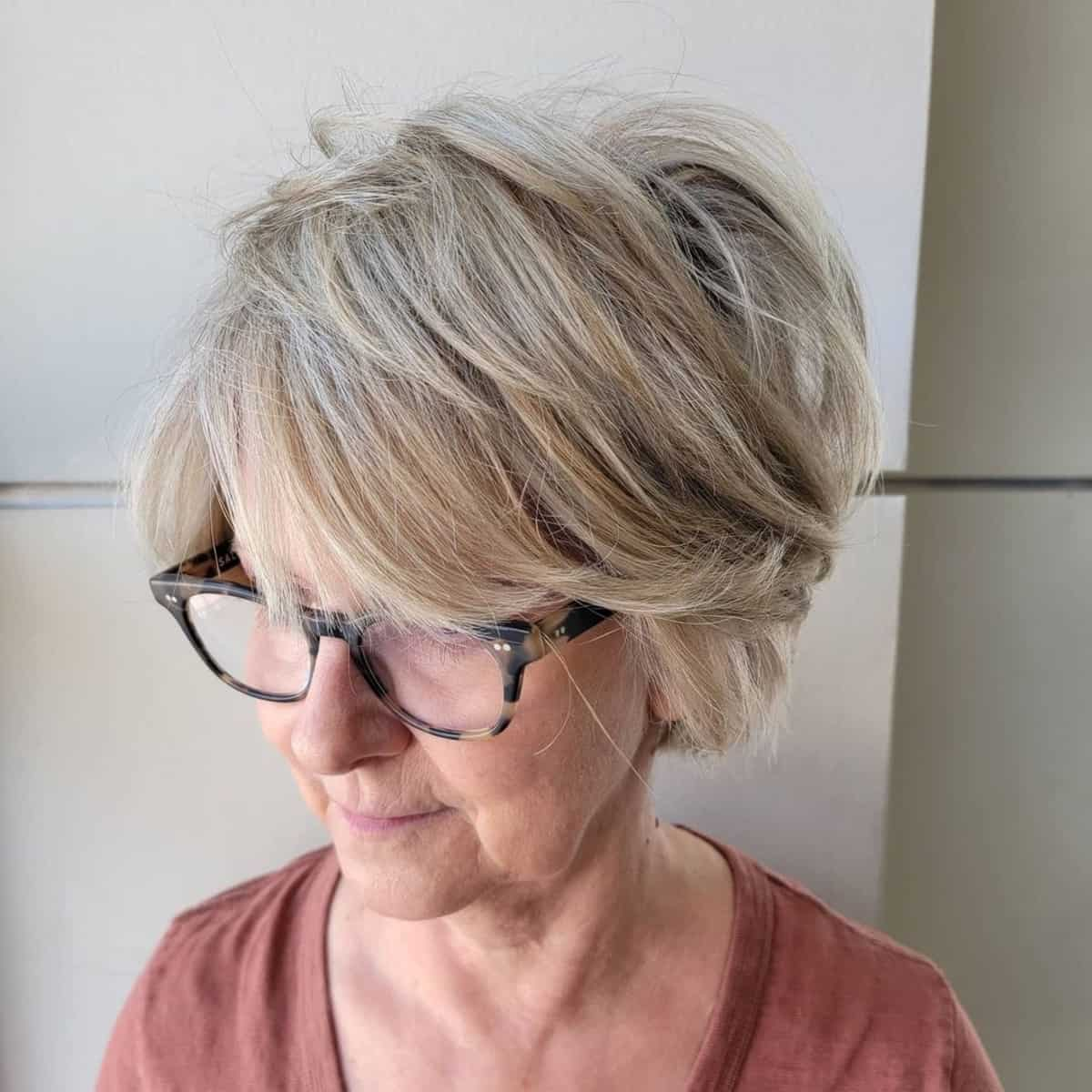 Tousled razor cut bob with glasses for ladies in their 60s