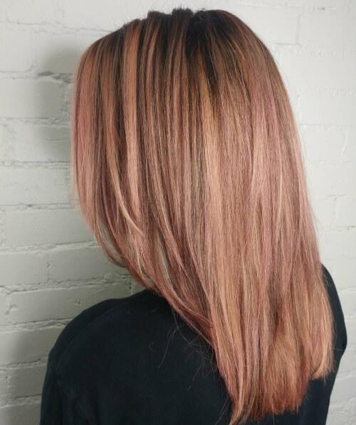 peachy rose gold hair color