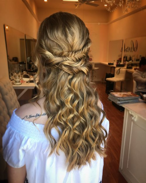Picture of a peekaboo fishtail braid curly hairstyle for prom