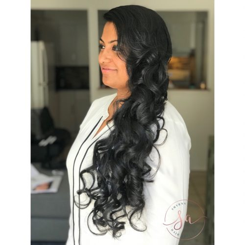 Picture of a perfect bridesmaid curls side swept hairstyle